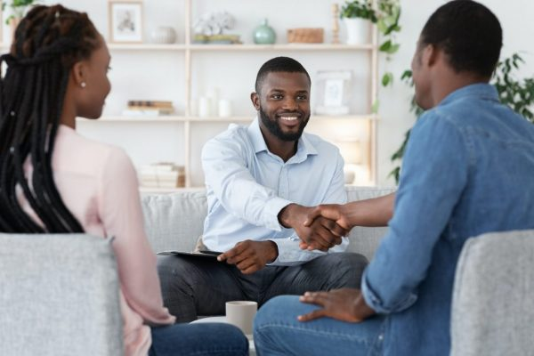 thankful-black-couple-and-marital-therapist-shaking-hands-after-successful-meeting-1024x682